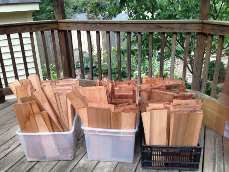 Cedar shakes removed carefully, one at a time, then sorted, wrapped, and stored.  Huge amount of nail holes to be filled.